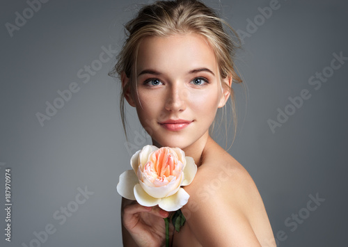 Beautiful girl with beautiful makeup. Photo of blonde girl with rose on grey ...