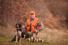 Hunters With Dogs Hunting A Bi...