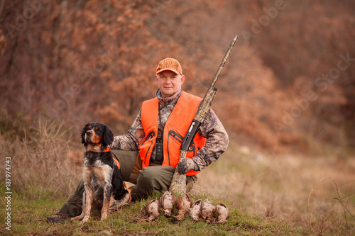 Fotografia, Obraz  hunters with dogs hunting a bird woodcock