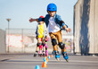 Leinwanddruck Bild - Young inline skater practicing forward slalom
