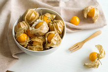 Cape Gooseberry Fruit On White Wooden Background