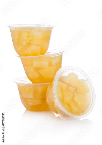Single cups with pineapples in fruit jelly