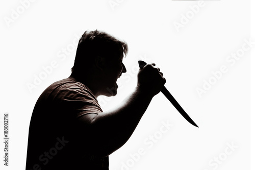 Photo An aggressive man attacks with a knife