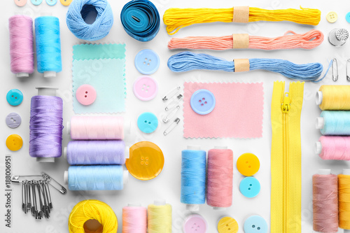 Composition with sewing threads and accessories on white background, top view Canvas Print