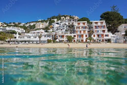 Poster de jardin Europe Méditérranéenne Mediterranean beach shore with buildings in Spain Costa Brava, seen from sea surface, playa Almadrava, Canyelles Grosses, Roses, Girona, Catalonia