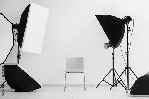 Interior of modern photo studio with chair and professional equipment Canvas-taulu