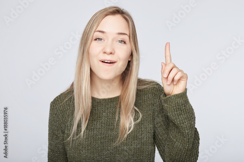 Cuadros en Lienzo Positive glad female says: wow how exciting it is, has amazed expression, indicates at blank copy space for your advertisement or promotional content