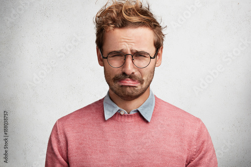 Bewildered displeased sorrorful man going to cry as sees no way out in difficult Canvas Print