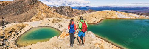 Fototapeta New Zealand volcanic mountain landscape in Tongariro Alpine Crossing National Park. Young people couple hikers tramping in NZ travel adventure, panoramic banner background. obraz