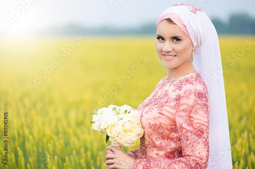 Beautiful young oriental bride preparing for wedding  Muslim