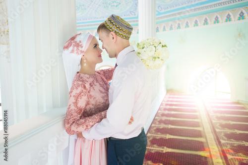 Fotografie, Obraz  Muslim bride and groom at the mosque. Wedding ceremony