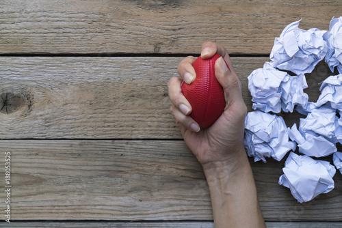 Fotografie, Tablou  Hand of a woman squeezing a stress ball with crumpled paper