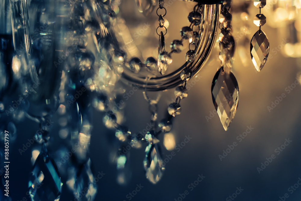 Fototapeta Crystal chandelier close-up. Glamour background with copy space