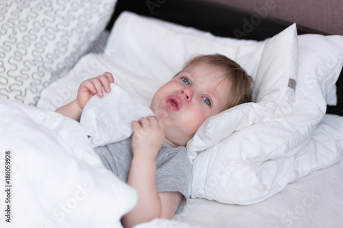 Little Kid Boy With Sore Throat Cough In The Bed Close Up Kaufen