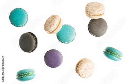 Foto op Canvas Macarons flying Colorful macarons on white background. Minimal pattern, creative dessert concept