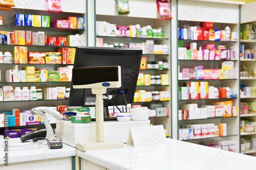 Tuinposter Apotheek Cash desk - computer and monitor in a pharmacy. Interior of drug and vitamins shop. Medicines and vitamins for health and healthy lifestyle