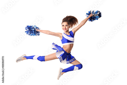 Cuadros en Lienzo Young cheerleader in blue and white suit with pompoms on white background