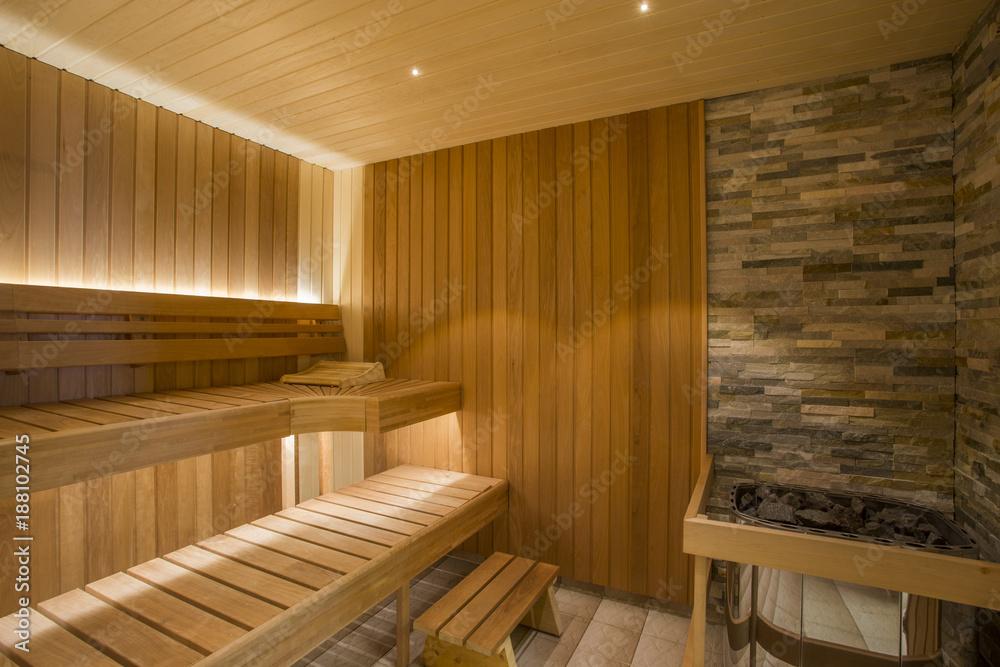 Fototapeta Sauna interior - Relax in a hot sauna