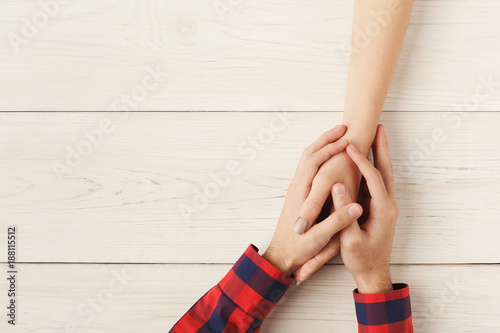 Top view of a male and female holding hands Fototapet