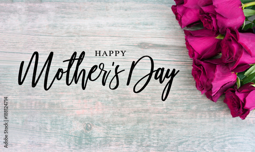 Happy Mothers Day Typography With Colorful Pink Roses In Corner Over Rustic Wood Background
