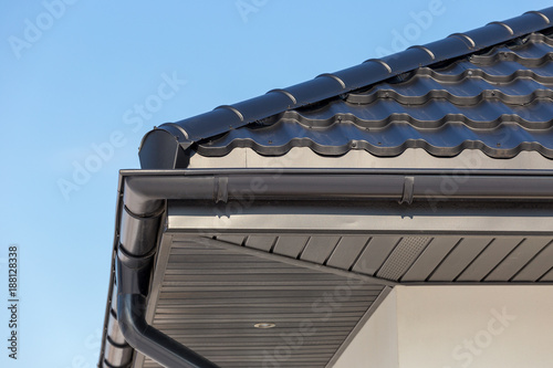 Fototapeta Corner of the new modern house with gutter roof and wall obraz