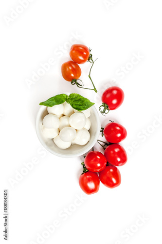 Fresh Cherry Tomatoes (mini) and Mozzarella cheese on a clean white background. Isolated.