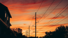 Power Lines Silhouette Against...