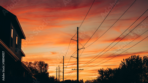 Valokuvatapetti Power Lines Silhouette Against A Beautiful Sunset Sky