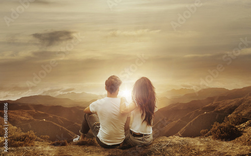 Tuinposter Artist KB Relaxed couple watching a sunset