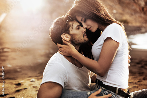 Tuinposter Artist KB Handsome man hugging his sensual girlfriend