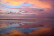 Empty Kuta beach with amazing colors sunset and sky reflection, Bali, Indonesia