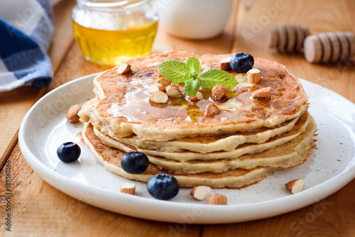 Gluten free almond pancakes with blueberries and honey. Closeup view