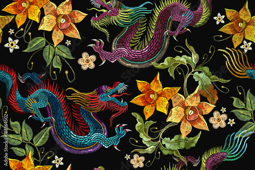Embroidery dragons and narcissus flowers seamless pattern