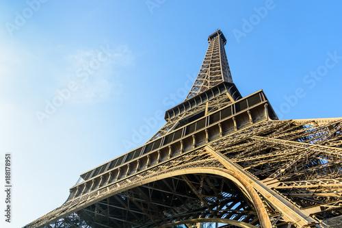 Deurstickers Eiffeltoren Dynamic view from below of the Eiffel Tower against blue sky.