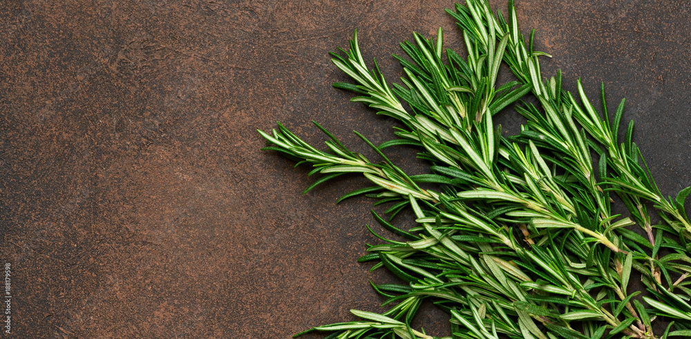 Fototapety, obrazy: A fresh bunch of rosemary on a brown concrete background. Organic food background.