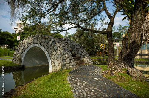 Photo  A stone Bridge at Toa Payoh Town Park provides a walkway over a pond