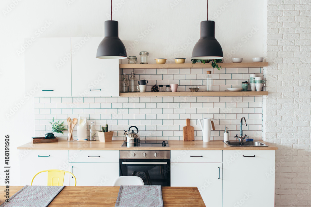 Fototapety, obrazy: Modern new light interior of kitchen with white furniture and dining table.