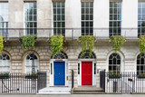Fototapeta Londyn - Town house with red and blue door, London, UK