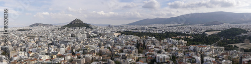 Fotobehang Athene Athens, Greece day view ranging from Mount Lycabettus to Panathenaic Stadium. Panoramic view of Lykavittos hill, The Greek Parliament in the center and to the far right the Temple of Olympian Zeus.