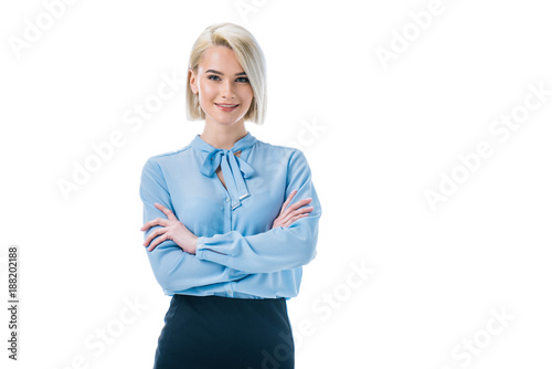 Photo  beautiful smiling businesswoman posing in formal wear with crossed arms, isolate