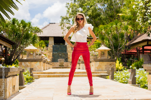 5583f789bcb Stylish woman in red leather pants and high heels - Buy this stock ...
