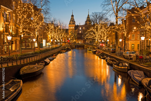 Spoed Foto op Canvas Amsterdam Christmas time in Amsterdam with the Rijksmuseum in Netherlands at twilight