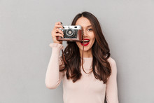 Image Of Pretty Female Photographer Holding Retro Camera Doing Favorite Shots Isolated Against Gray Background Copy Space
