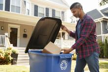 Man Filling Recycling Bin On S...