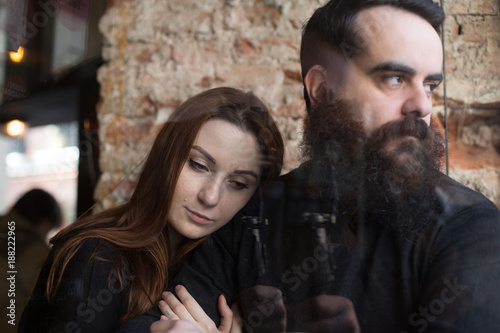 Couple in struggle or conflict, sad and distant with cold