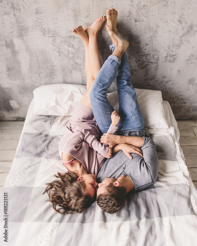 Photo  Passionate beautiful couple in bedroom enjoying foreplay