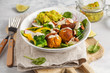 Vegan baked sweet potato meatballs, guacamole and vegetables salad. Light background, healthy vegetarian food concept, copy space.