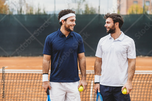 Portrait of a couple of young men engaged in a tennis match