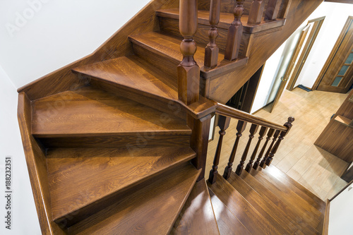 Close-up detail of brown wooden stairs Fototapeta