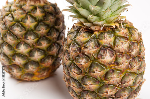 Fototapety, obrazy: two big pineapples on a white background